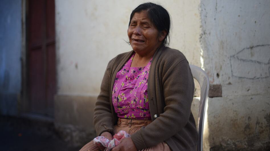 A relative mourns the ten members of the Vasquez family who died in the earthquake in the San Cristobal Cuchu municipality in San Marcos, Guatemala. (AFP/Getty Images)