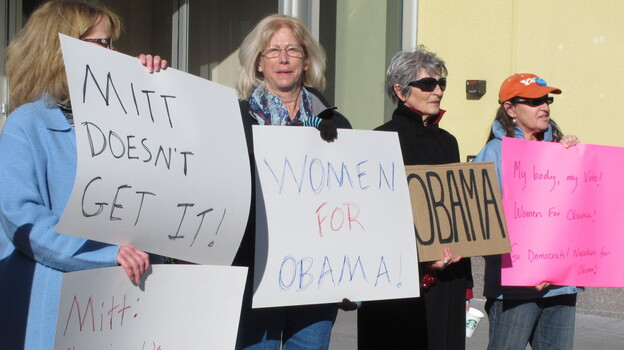 On Oct. 24, women backing President Obama protest outside a convention center in Reno, Nev., where Republican Mitt Romney was giving a campaign speech. Exit polls show significant support from women was a key factor in Obama's victory over Romney in Nevada. (AP)