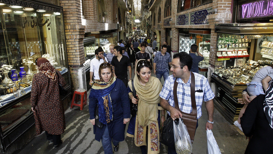 Iranians make their way through Tehran's main bazaar. Iran's economy is under increasing strain, and its currency has fallen sharply.