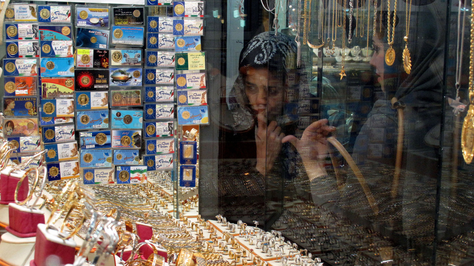 Iranian women look at a jewelry shop display in Tehran, Iran, in 2010. Iran now appears to be stockpiling gold in an attempt to stabilize its economy, which has been hit hard by Western sanctions. (AFP/Getty Images)