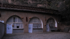 Xi lived in the cave house on the far right, in Liangjiahe village in central China. After his father's political downfall in Beijing, his parents sent him there when he was 15 in 1968.