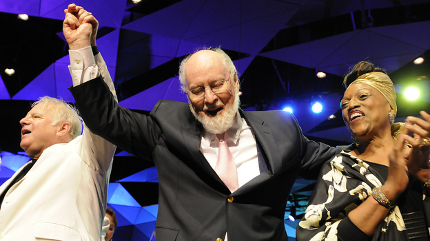 Flanked by composer Leonard Slatkin and soprano Jessye Norman, John Williams takes a bow during his 80th-birthday celebration at Tanglewood in August. (Stu Rosner)