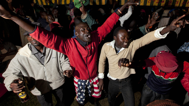 Kenyans dance at a watch party for the U.S. presidential election in Kogelo village, home to President Obama's step-grandmother. Kenyans were elated by the president's re-election. (AP)