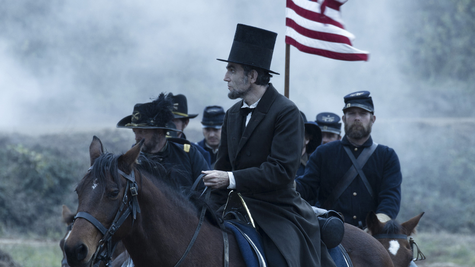 President Abraham Lincoln (Daniel Day-Lewis) looks across a battlefield in the aftermath of a terrible siege in Lincoln. (DreamWorks)