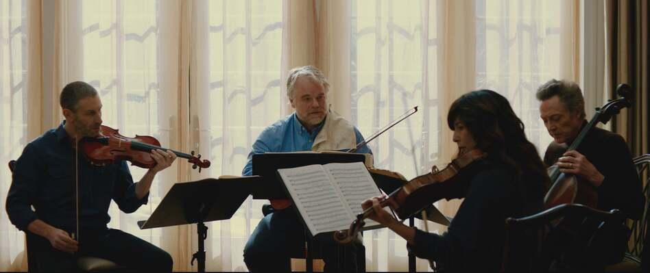 Mark Ivanir, Philip Seymour Hoffman, Christopher Walken and Catherine Keener as the Fugue String Quartet.