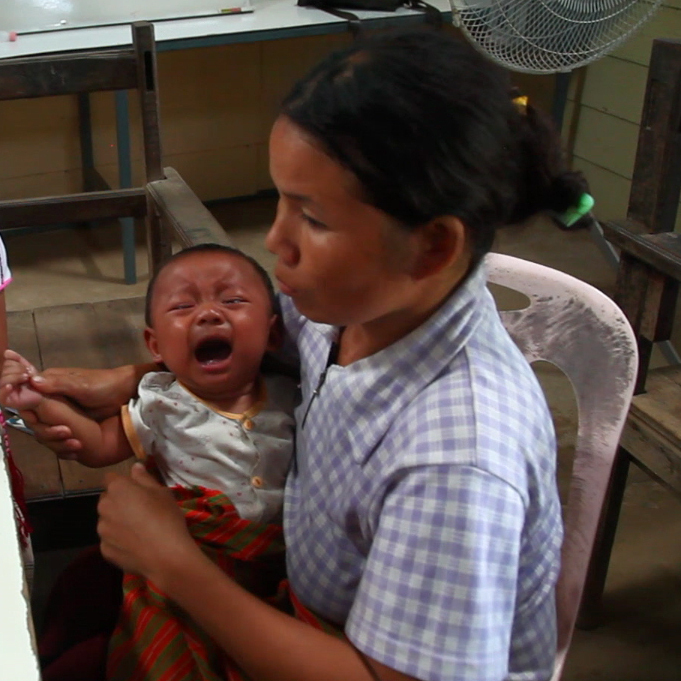 Medical staff at the Whampa clinic on Thailand-Burma border take a small blood sample from an infant to test for malaria. Children under the age of 5 are especially vulnerable to the disease.