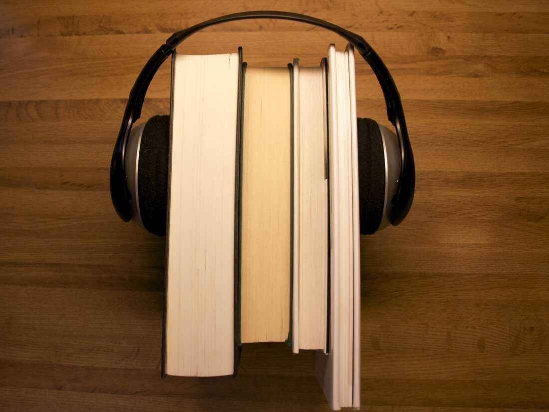 books with headphones on
