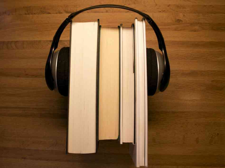 books with headphones on