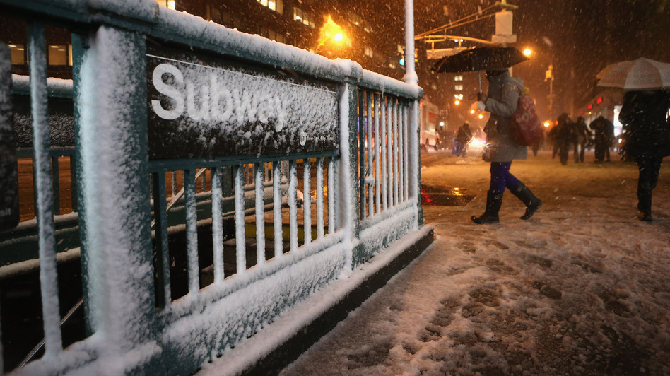 Snow and high winds blew into the New York-New Jersey region Wednesday. Things were getting messy here, in Manhattan's Union Square. (Getty Images)