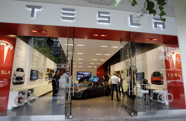 A Tesla Motors showroom in San Jose, Calif. Car dealers in New York and Massachusetts have filed a lawsuit that seeks to block Tesla from selling its vehicles in those states.