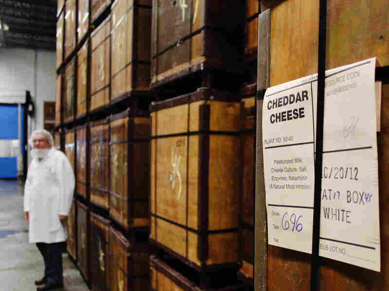 Wooden containers hold 640-pound blocks of cheddar cheese.