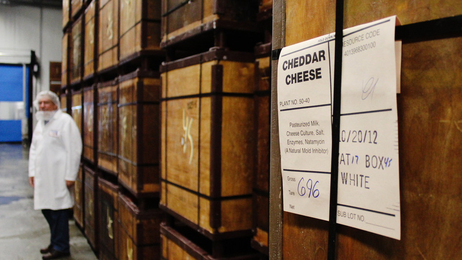 Wooden containers hold 640-pound blocks of cheddar cheese. (NPR)