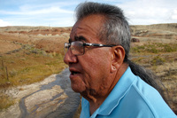Wes Martel, vice chairman for the Eastern Shoshone Business Council, stands near a murky gray stream full of oil field wastewater. He's concerned about the effects the wastewater has on wildlife, water quality and, since cows drink it, he wonders: