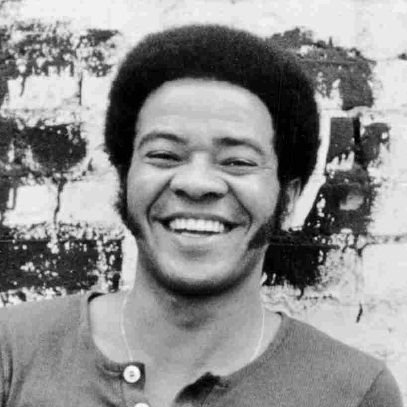 Bill Withers posing for a portrait around 1973.