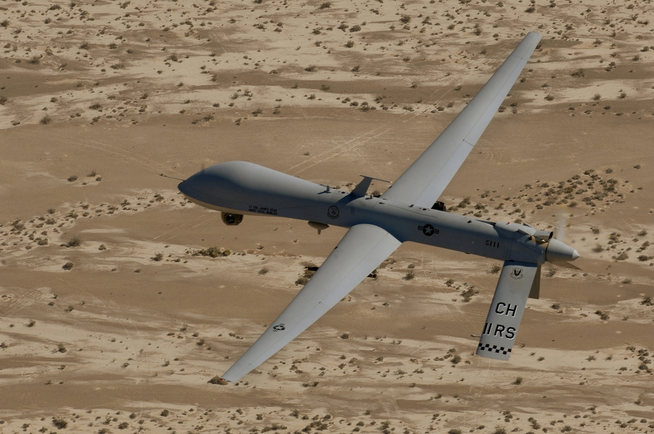 In this Sept. 6, 2007 photo, an MQ-1 Predator unmanned aerial vehicle flies over a range in Nevada.