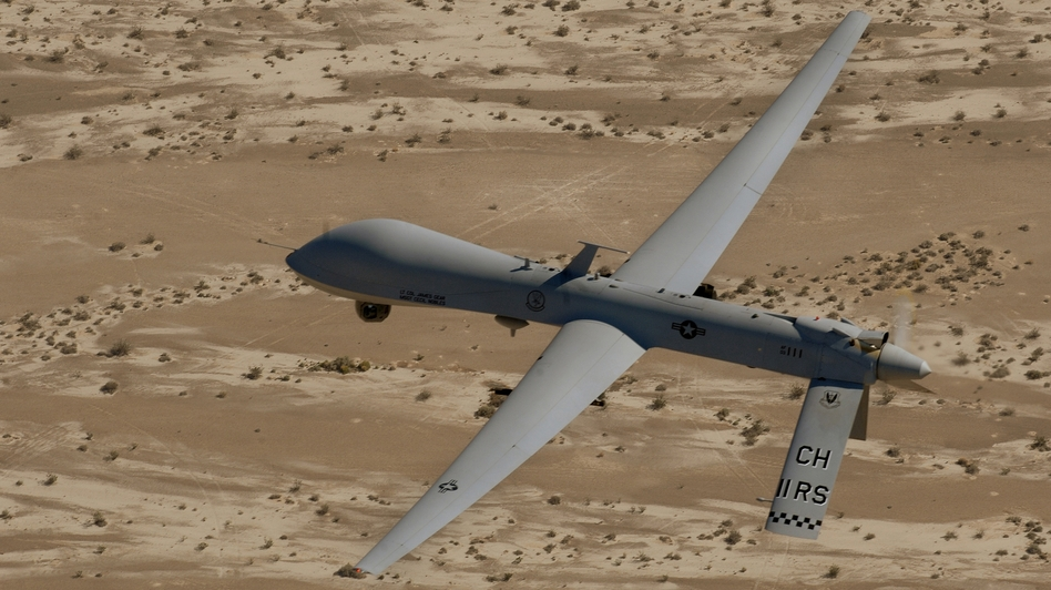 In this Sept. 6, 2007 photo, an MQ-1 Predator unmanned aerial vehicle flies over a range in Nevada. (AP)