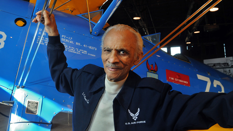 Former Tuskegee Airman Herbert Carter, in January at the Tuskegee Airmen National Historic Site in Alabama. Behind him: A  PT-17 trainer aircraft. (AP)