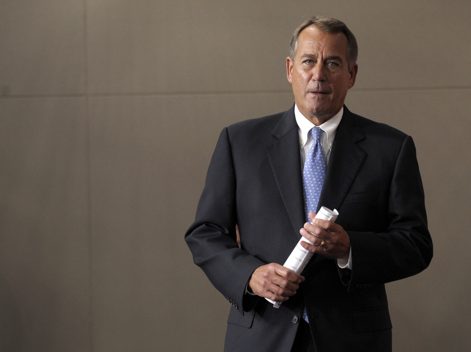 House Speaker John Boehner arrives for a news conference on Capitol Hill on Friday. (AP)