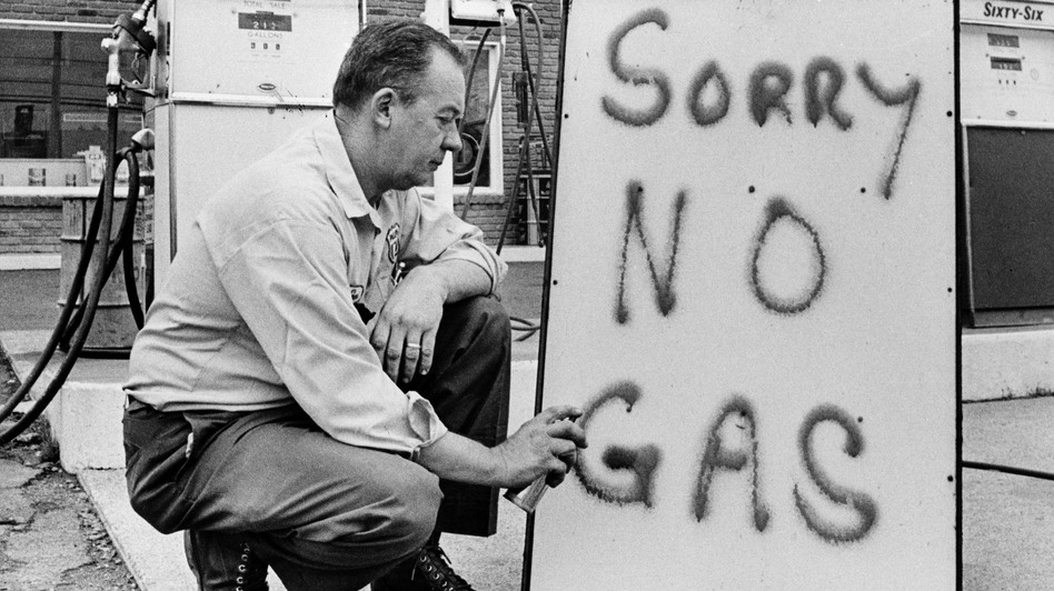 Leon Mill spray paints a sign outside his Phillips 66 station in Perkasie, Pa., on June 1, 1973, to let his customers know he's out of gas. An oil crisis was the culprit, squeezing U.S. businesses and consumers who were forced to line up at gas stations for hours. (AP)