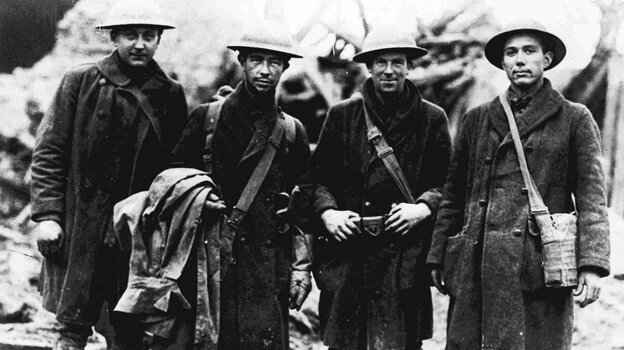 Four U.S. soldiers, runners for the 315th Infantry, pose in France in November 1918. The troops reportedly carried official orders to Lt. Col. Bunt near Etraye, France, shortly before noon, Nov. 11, 1918, announcing that the armistice had been signed, thereby ending World War I. (AP)