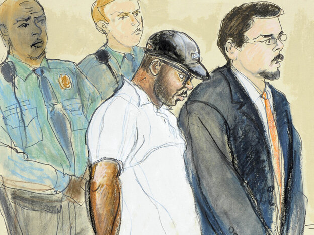 In this courtroom drawing, Aaron Thomas, stands before a judge with officers and public defender Joseph Lopez, in New Haven, Conn., on March 7, 2011.