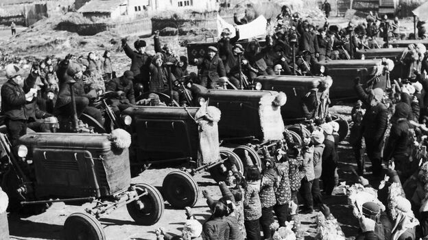Chinese villagers welcome the arrival of tractors purchased by a farmers' cooperative in April 1958, during the Great Leap Forward campaign. The disastrous modernization program ended in China's great famine and tens of millions of deaths. (Gamma-Keystone via Getty Images)