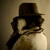 Woman in Indiana Jones style hat