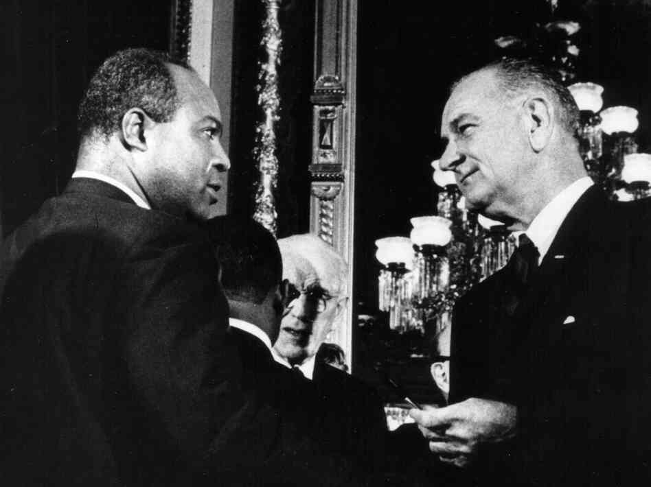 Aug. 6, 1965: President Lyndon B. Johnson presents one of the pens used to sign the Voting Rights Act of 1965 to James Farmer, Director of the Con