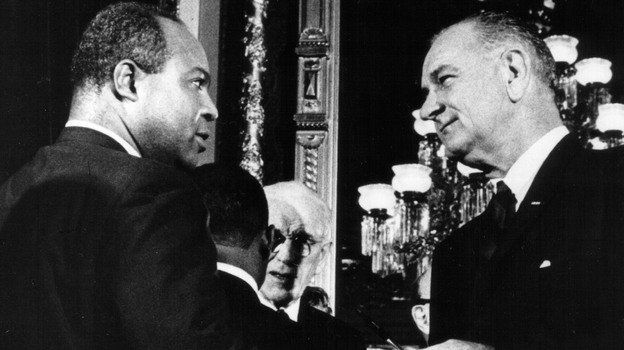 Aug. 6, 1965: President Lyndon B. Johnson presents one of the pens used to sign the Voting Rights Act of 1965 to James Farmer, Director of the Congress of Racial Equality. (Getty Images)