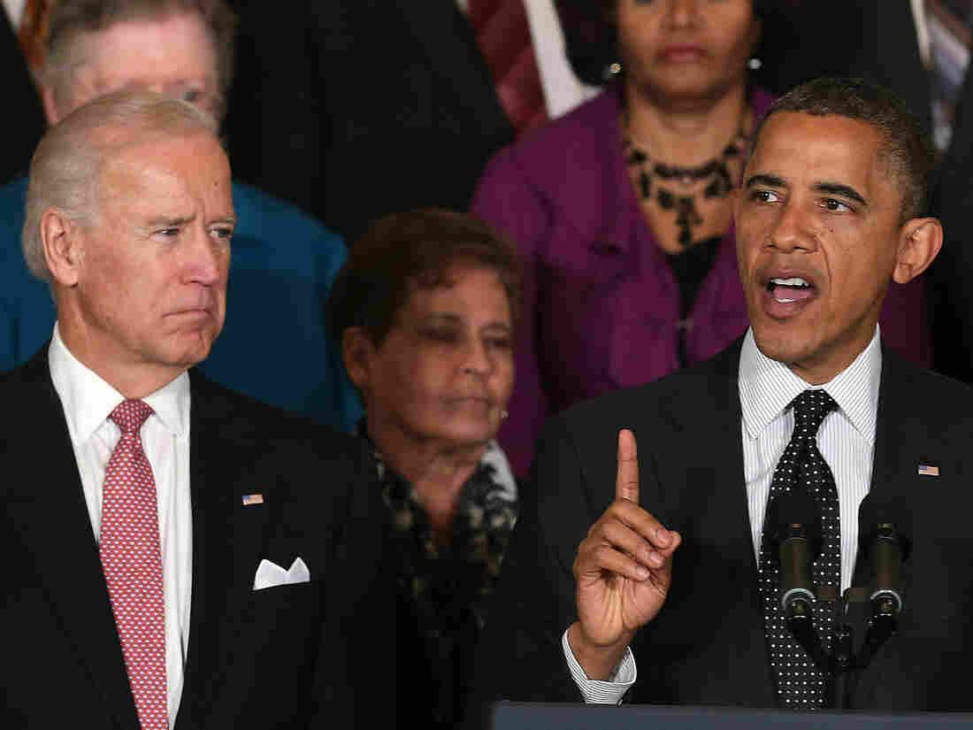 Vice President Biden looks on as President Obama speaks at the White House.