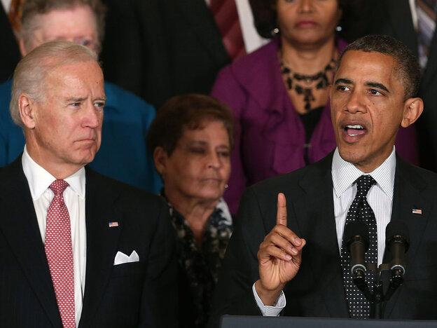 Vice President Biden looks on as President Oba