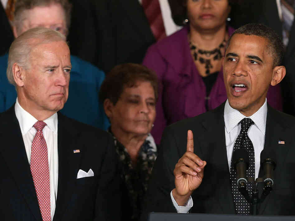 Vice President Biden looks on as President Obama speaks at the White House.