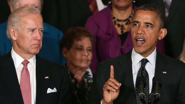 Vice President Biden looks on as President Obama speaks at the White House. (Getty Images)