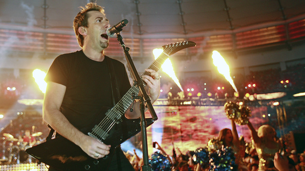 Nickelback's Chad Kroeger performs during halftime of a Canadian football game in Vancouver. On the band's own tours, expensive pyrotechnics are more rare. (Getty Images)