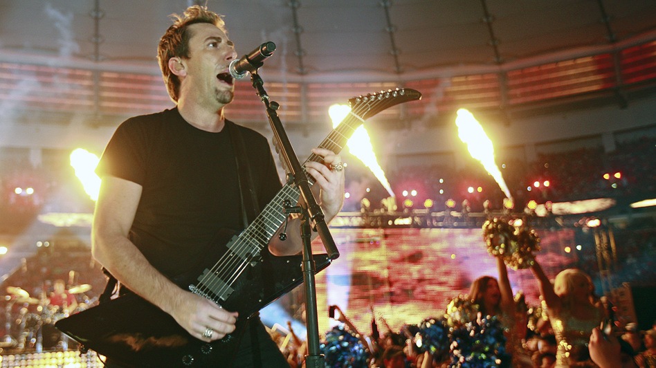 Nickelback's Chad Kroeger performs during halftime of a Canadian football game in Vancouver. On the band's own tours, expensive pyrotechnics are more rare.