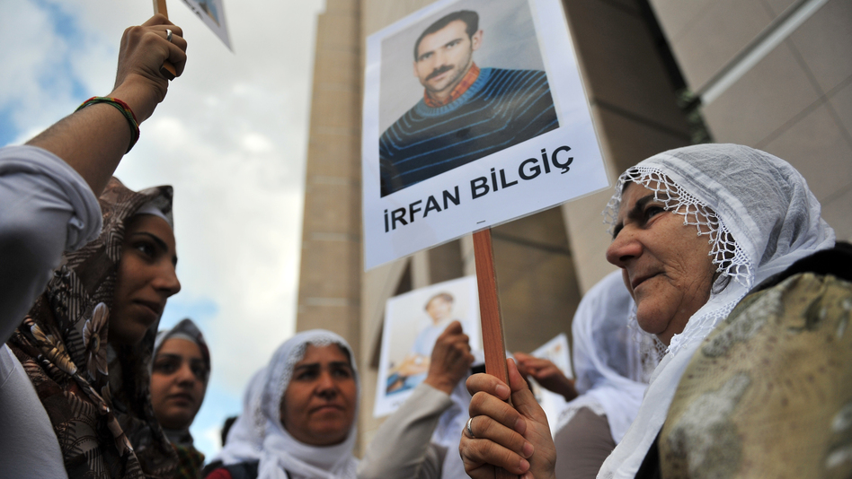 Kurdish women hold pictures of jailed journalists in Istanbul on Sept. 10, during the start of the trial of 44 journalists with suspected links to rebels from the Kurdistan Workers' Party.