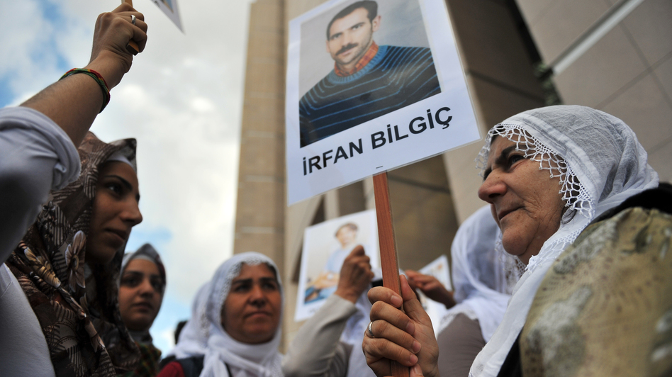 Kurdish women hold pictures of jailed journalists in Istanbul on Sept. 10, during the start of the trial of 44 journalists with suspected links to rebels from the Kurdistan Workers' Party. (AFP/Getty Images)