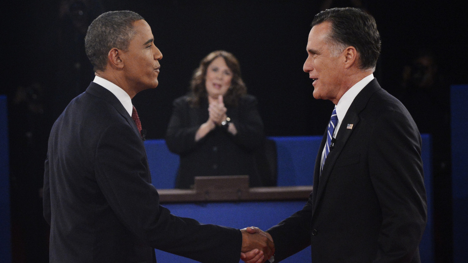 Moderator Candy Crowley applauds as President Obama shakes hands with former Massachusetts Gov. Mitt Romney during the second presidential debate on Oct. 16. (AP)
