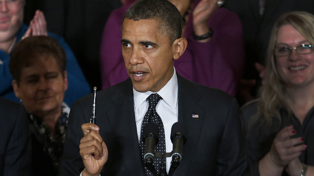 President Obama speaks about the economy and the deficit at the White House on Friday. He says this time around, he has proof that Americans agree with his approach. (AP)