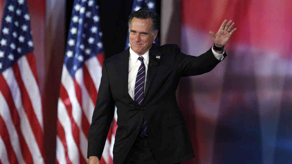 Former Massachusetts Gov. Mitt Romney waves to supporters  before giving his concession speech in Boston on Tuesday.