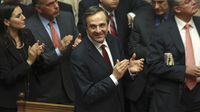 Greek Prime Minister Antonis Samaras and lawmakers from his New Democracy applaud after voting on the country's 2013 budget in Athens early Monday. Greek lawmakers approved the country's 2013 austerity budget, an essential step in Greece's efforts to persuade its international creditors to unblock a vital rescue loan installment without which the country will go bankrupt.