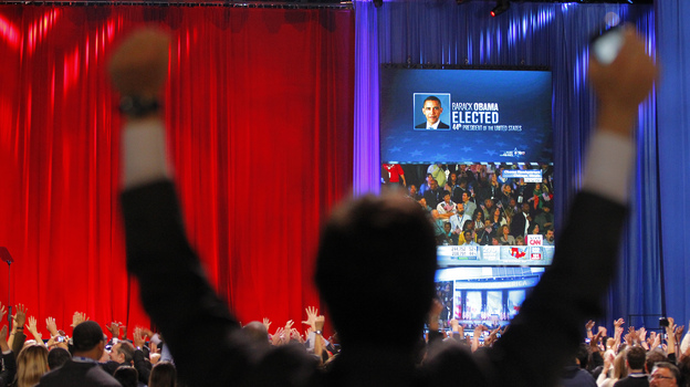 A supporter of President Barack Obama raises his arms as it is announced that Obama was re-elected during an election night watch party in Chicago. (AP)