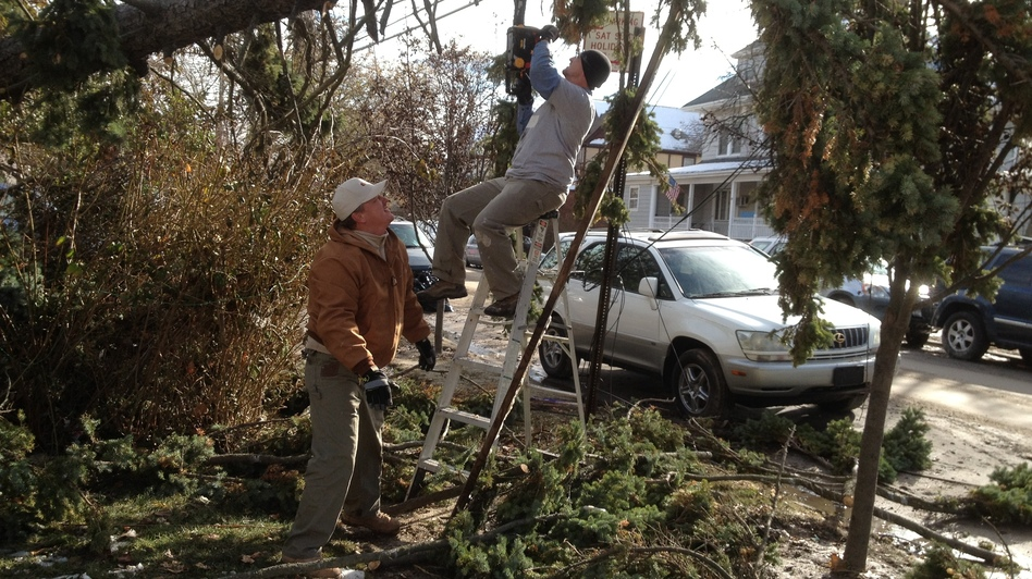 Veterans from around the country have deployed to the Northeast to help after Superstorm Sandy. Jeff Blaney (left) of San Francisco was in the Army and Jamie Havig was a Navy medic attached to the Marines in Iraq. (NPR)
