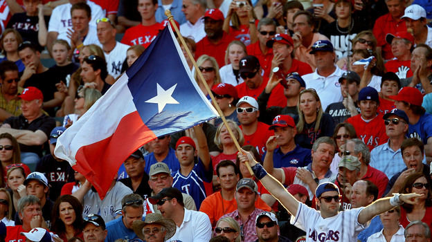 A fan holds up the Texas state flag during Game Two of the ALCS during the 2010 MLB Playoffs. (Getty Images)