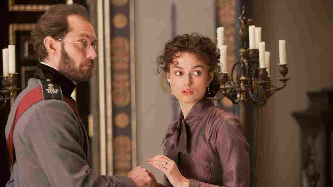 Karenin (Jude Law) tries to rein in his wife, Anna (Keira Knightley), as she pursues a flirtation and then an affair with a handsome young military officer in a new adaptation of Leo Tolstoy's iconic love story.