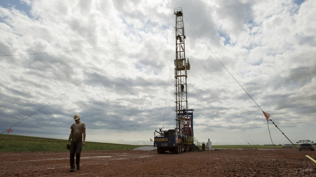 Austin Mitchell walks away from an oil derrick outside Williston, N.D., in July 2011. North Dakota is now the No. 2 producer of oil in the U.S. behind Texas. (AP)