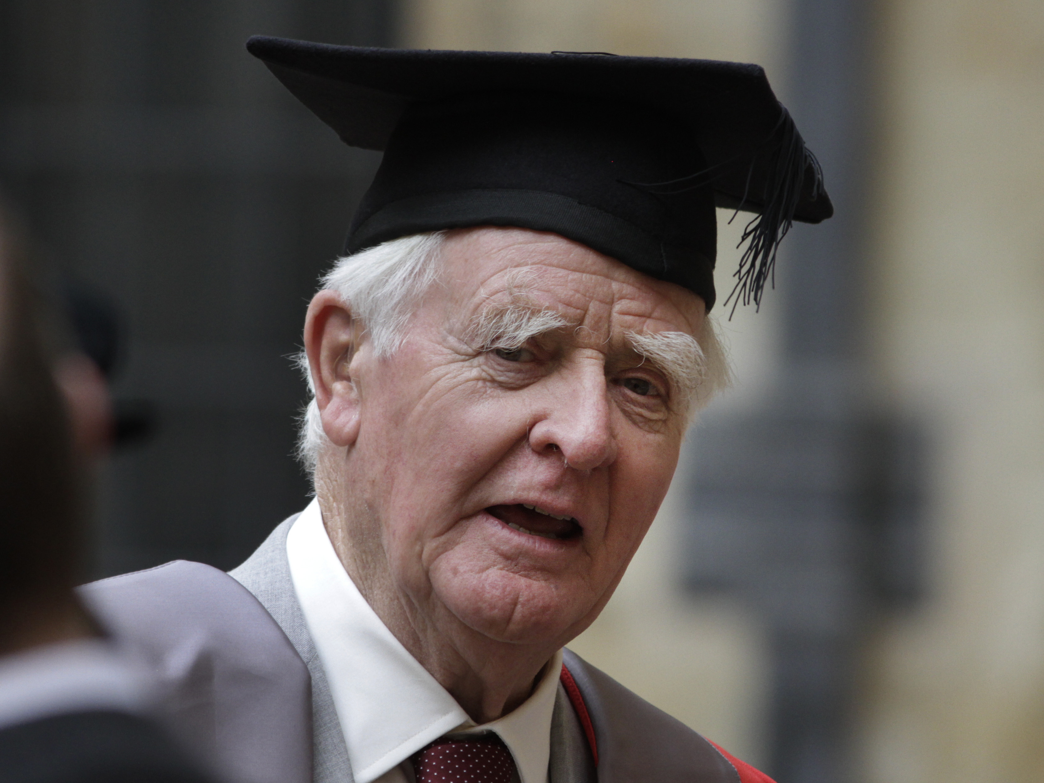 Author John le Carre poses for photographers following a ceremony at Oxford University on June 20.