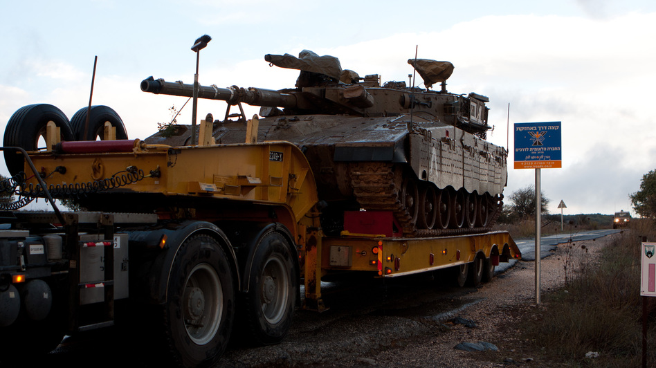 An Israeli armored vehicle at the entrance of Tel Hazeka Israeli army base in the Golan Heights on Sunday.