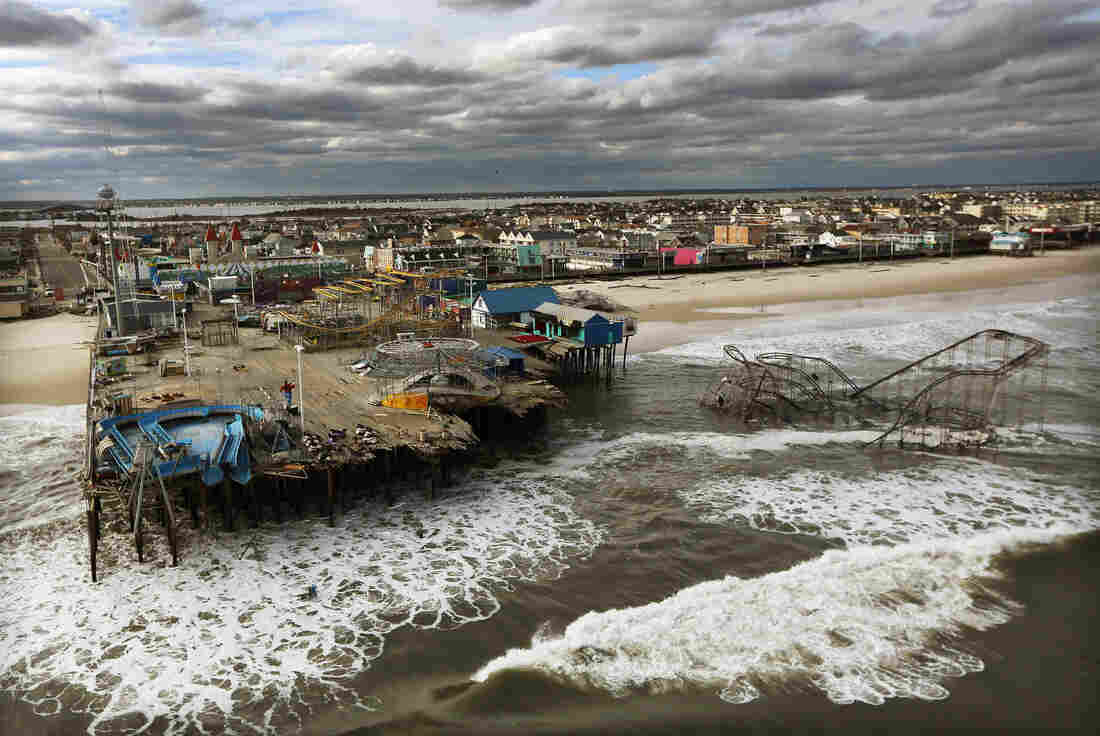 Waves break Oct. 31 in front of a destroyed amusement park wrecked by Hurricane Sandy in Seaside Heights, N.J.