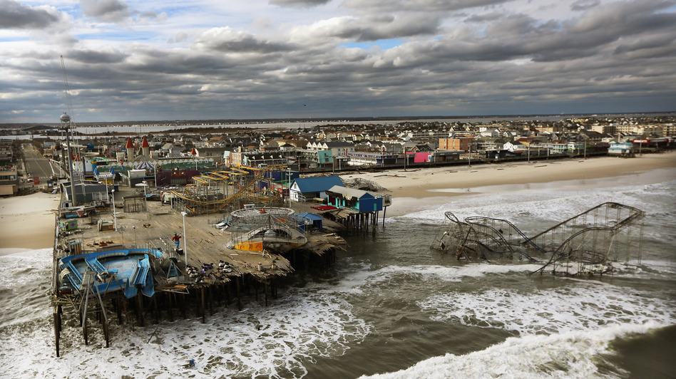 Waves break Oct. 31 in front of a destroyed amusement park wrecked by Hurricane Sandy in Seaside Heights, N.J. (Getty Images)